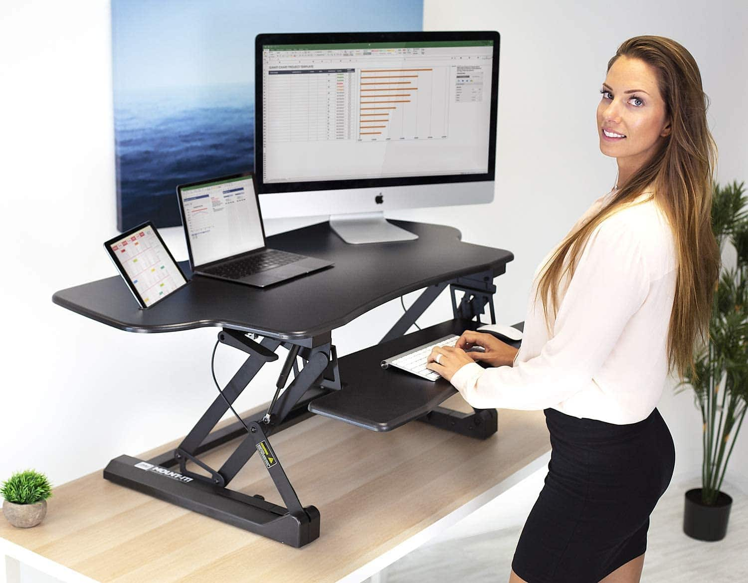 Sit stand desk for the work on the tabletop of another desk