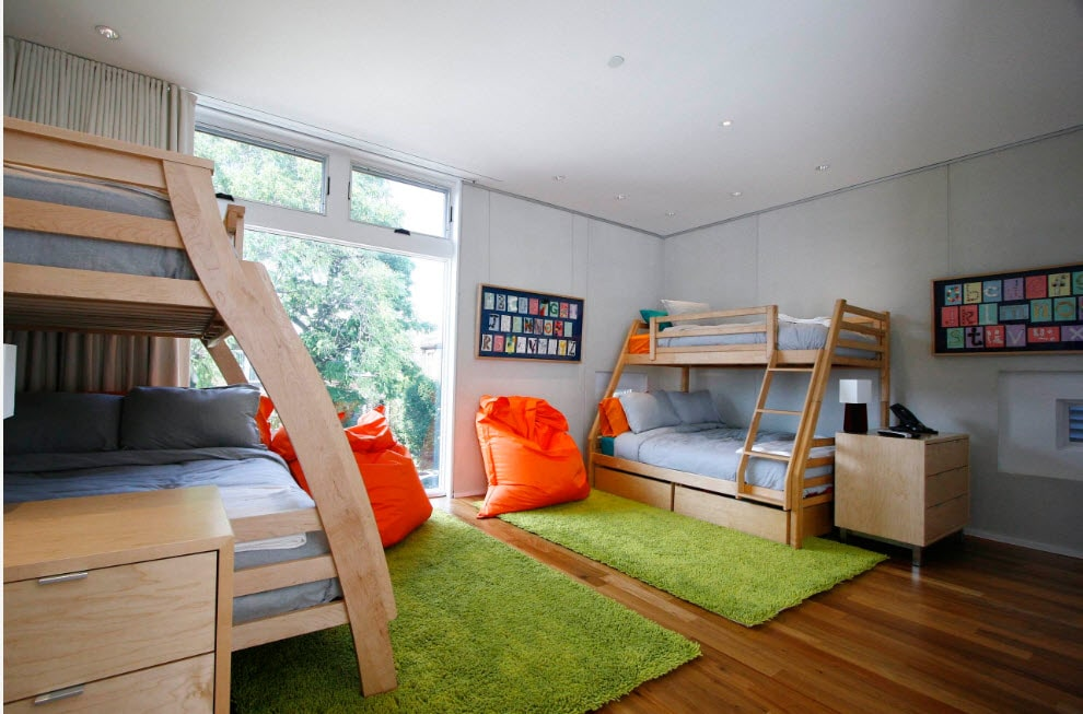 Bunk Bed as an Option to Enhance the Interior Functionality. Playground for children with green fluffy rugs and orange bean bags