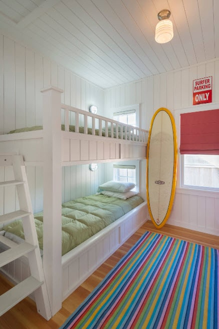 Bunk Bed as an Option to Enhance the Interior Functionality. Sporty touch to the teenagers room with colorful atmosphere and surfing board