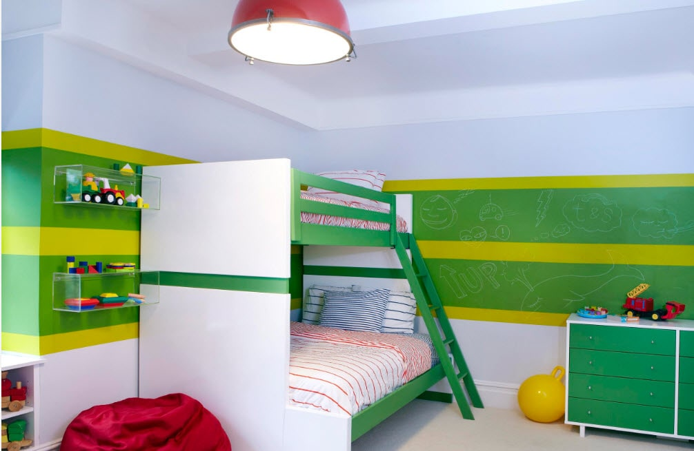 Green colored walls and large bunk bed with green sides