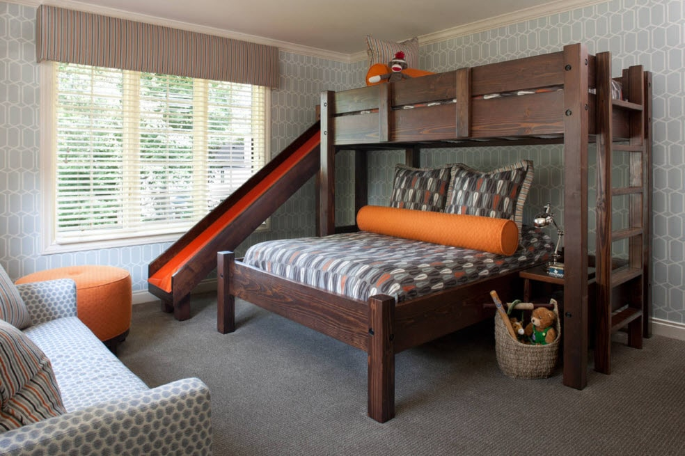 The dark wooden bunk bed in the form of slide with the ladder