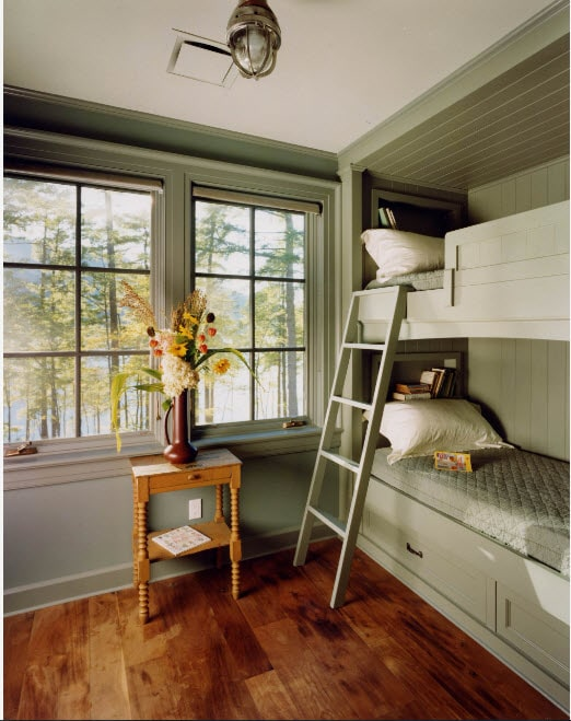 Bunk Bed as an Option to Enhance the Interior Functionality. Classic room with large sash windows and gray colored walls