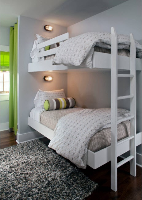 Gray walls and white bunk bed frame and ladder
