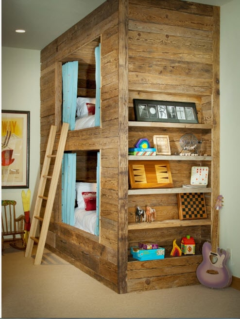 A real house made of bunk bed trimmed with wooden planks