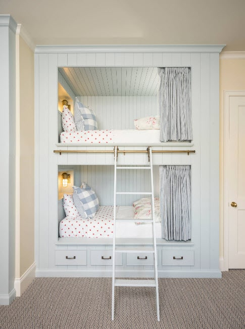 Classic white bunk bed with the storage system at the first level