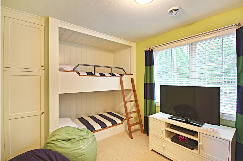 Great idea to organize two sleepers in joyfully colored room with bunk bed and TV