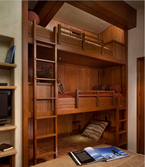 Bunk Bed as an Option to Enhance the Interior Functionality. The threee level bed with large ladder to the top for grown up kid