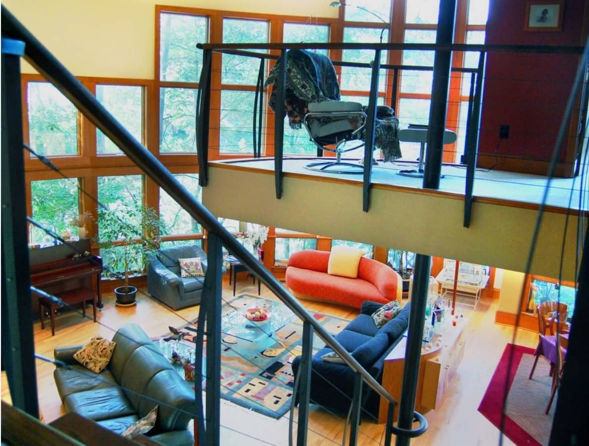 Home office in the form of cantilever balcony with black handrails