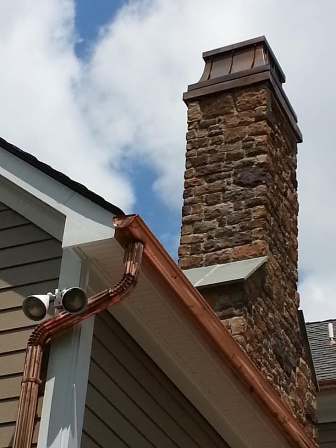 10 Signs Your Chimney Is In Need of Repairs. The Classic styled houes with stone trimmed flue