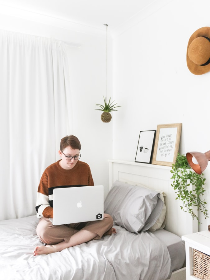 How to Create Privacy in a College Dorm. Great bedroom idea with cozy white blackout curtains and gray bedding