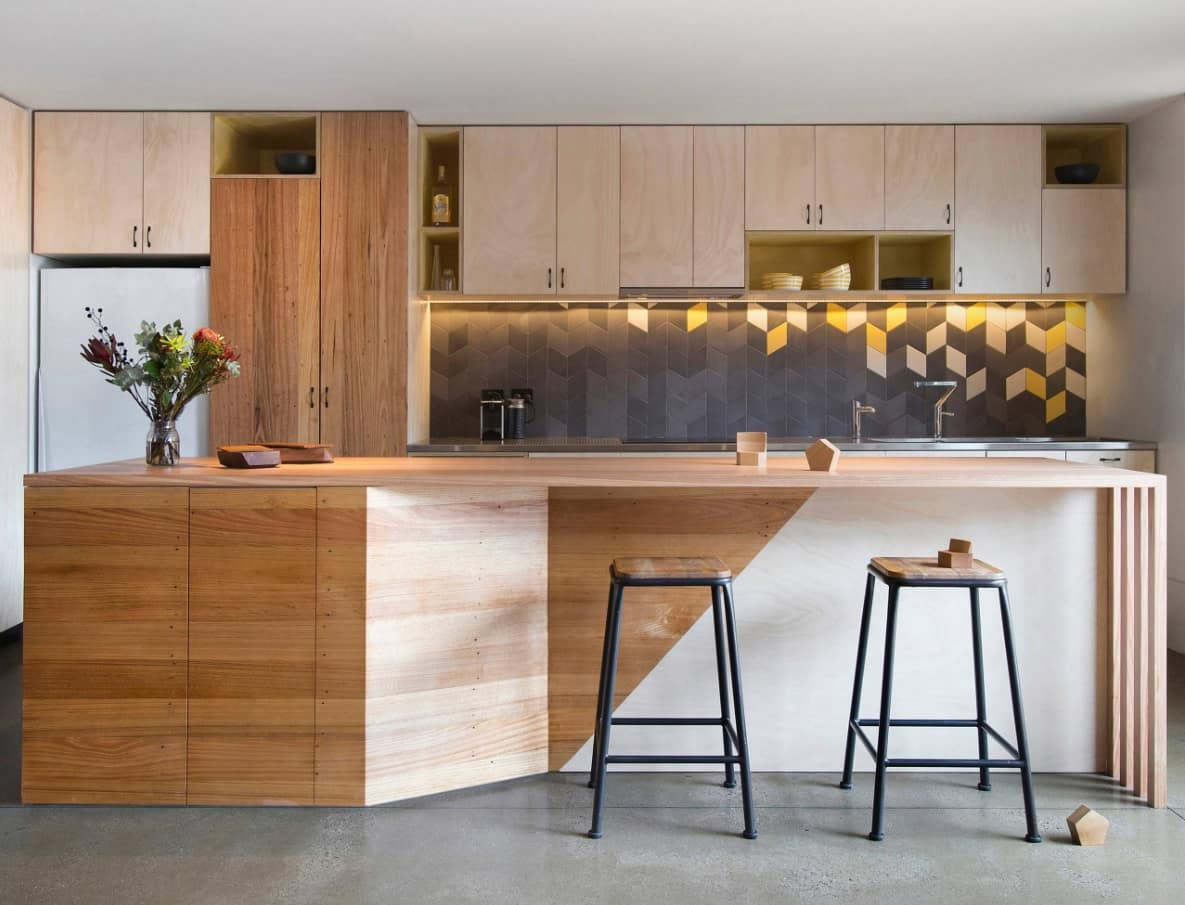 10 Amazing Ways to Give Your Kitchen a New Look. Wooden sheathed island and geometry tiles on the splashback