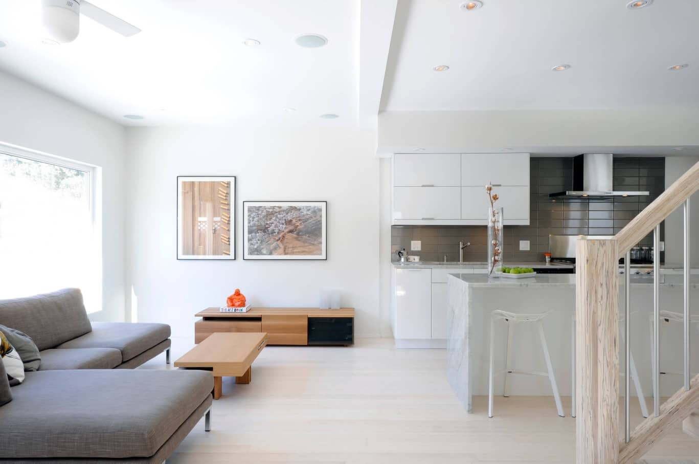 Casual white interior of the open layout apartment with kitchen zone and living