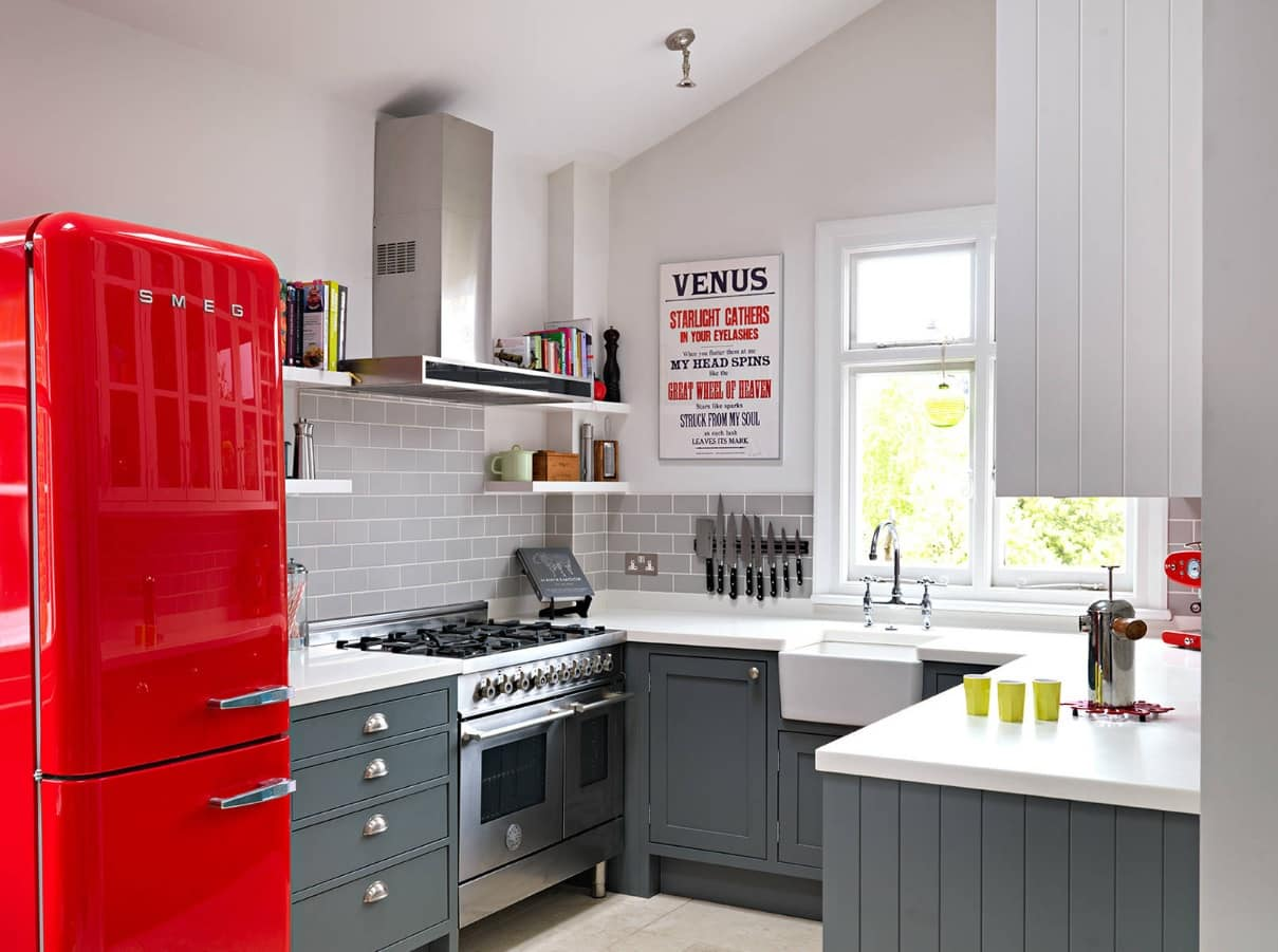 Gray cabinets and red retro fridge for classic kitchen with the sink at the window