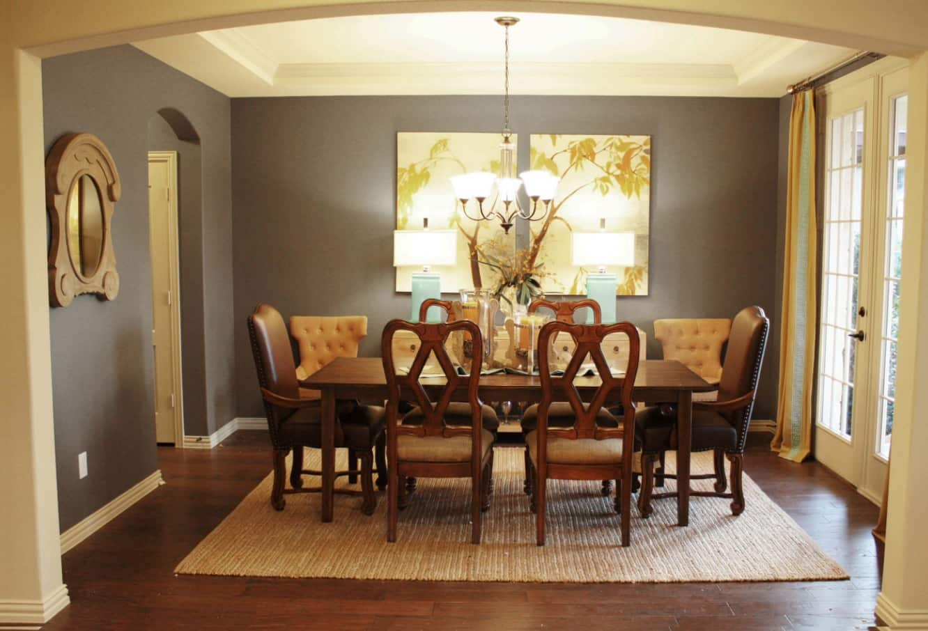 Modern Leather Dining Chairs to Complement the Interior. Brown chairs in the set for 8 persons and dark grey walls in the room