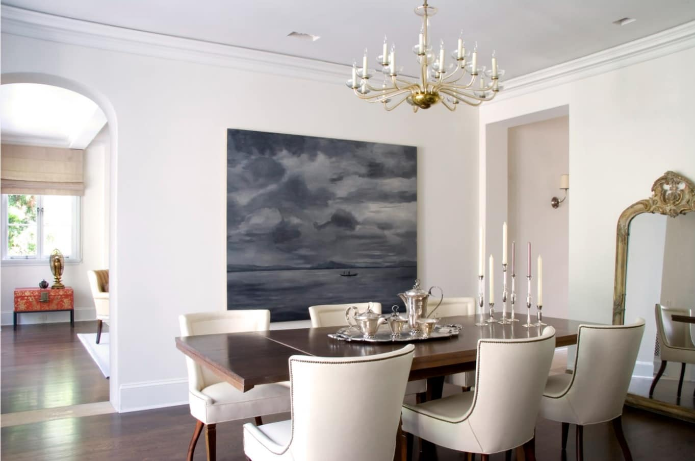 Totally light creamy colored dining room with decoartive painting of cloudy abstractions