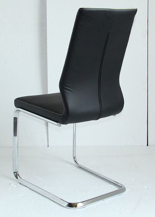 Modern Leather Dining Chairs to Complement the Interior. Chrome steel C-shaped frame and black top