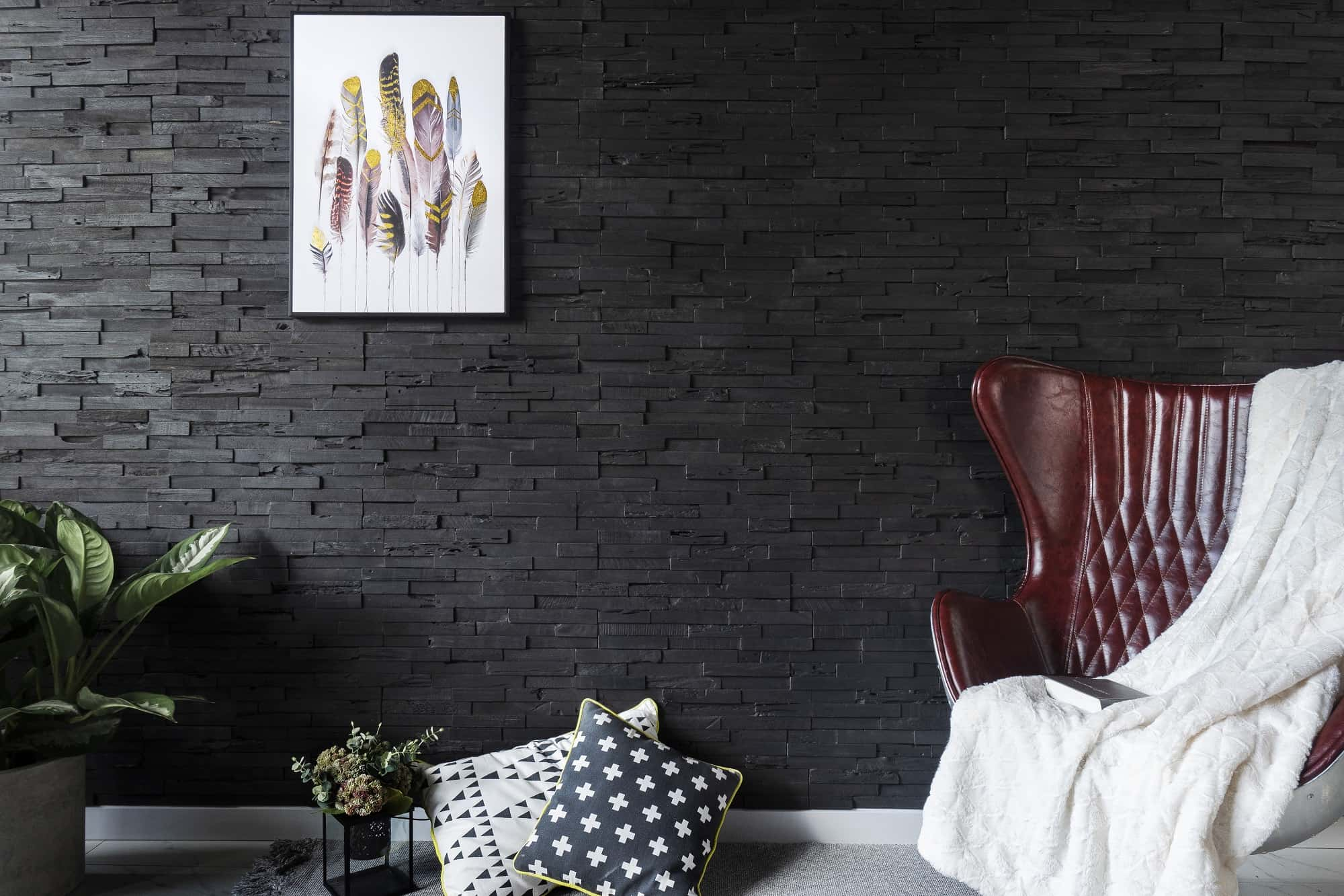 Reclaimed Wood Panels: An Eco-Friendly Way to Enhance Your Home Decor. Unusual and contrasting black planked wall