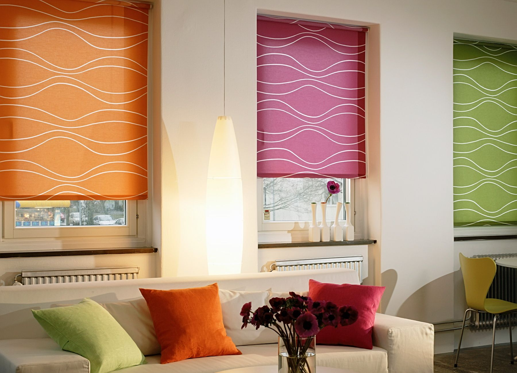 Bright colored roller blinds to revive the atmosphere