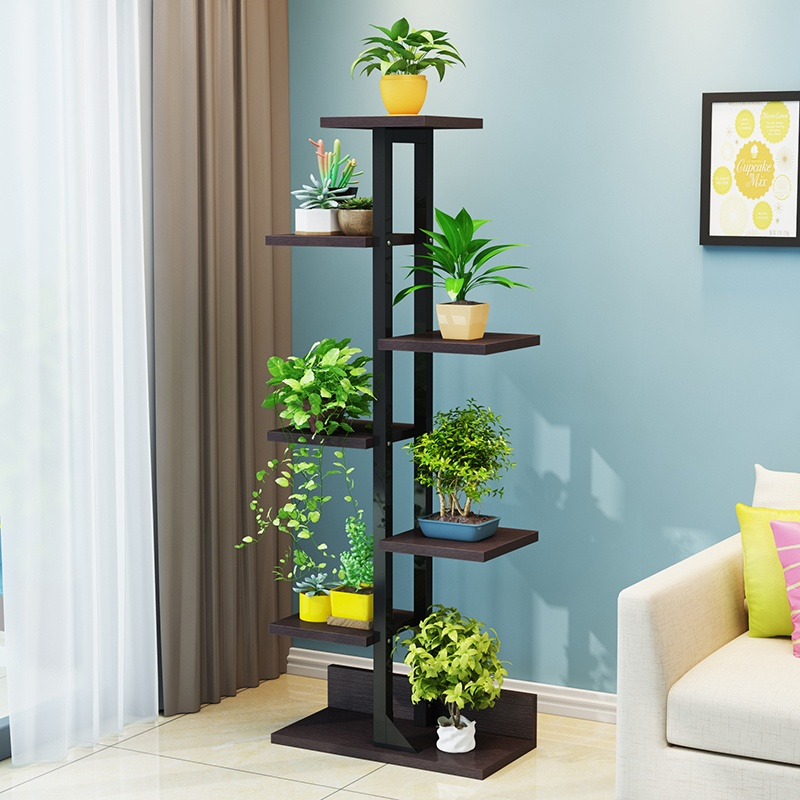 Straight wooden black flower stand in the casual living with blue walls
