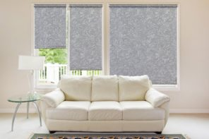 Roller Blinds: Practical and Good Looking Window Treatment. Nice gray textured curtains in modern living interior