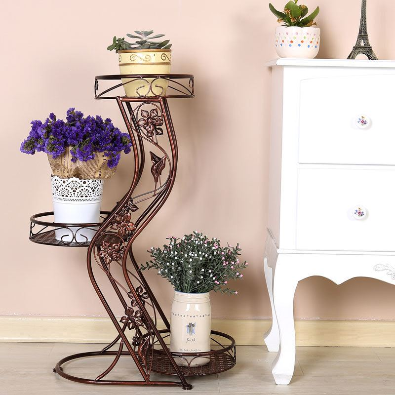 Flower Stands as Interior Complement: Fresh Ideas for Different Designs. Figured and forged stand with three slots