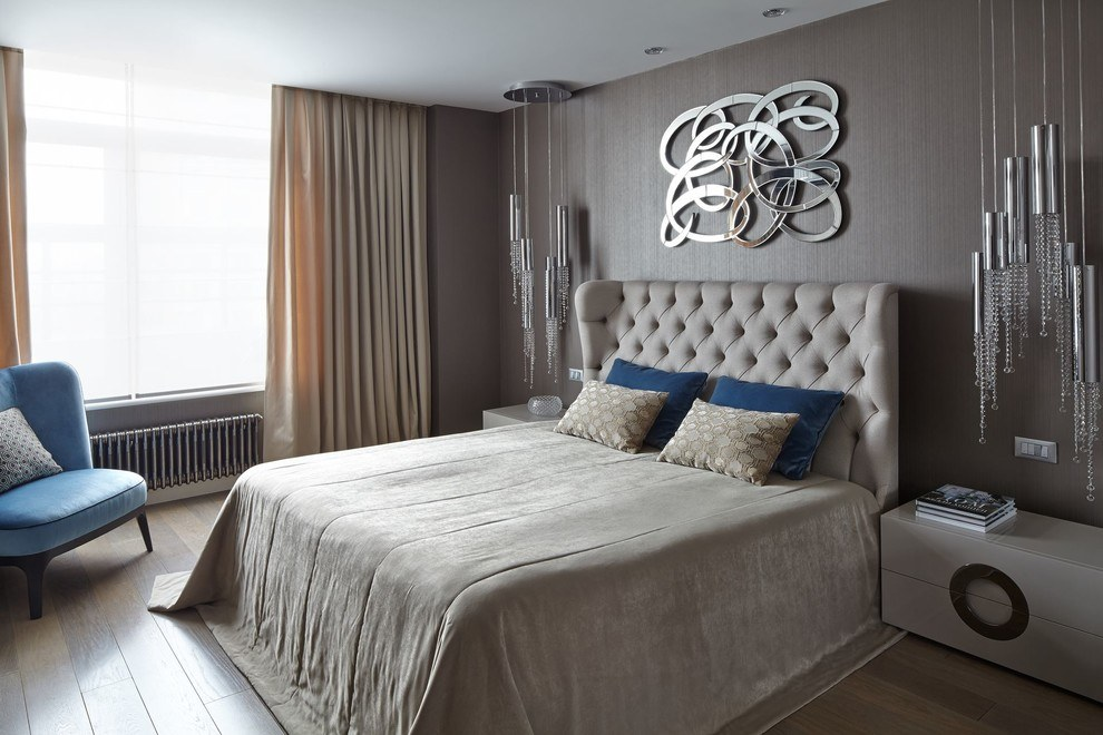 Quilted headboard with the impressionistic designed decoration above for the bedroom in gray colors