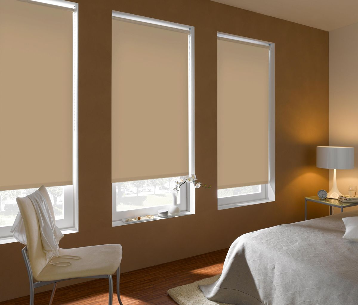 Light colored walls for cozy bedroom with three windows