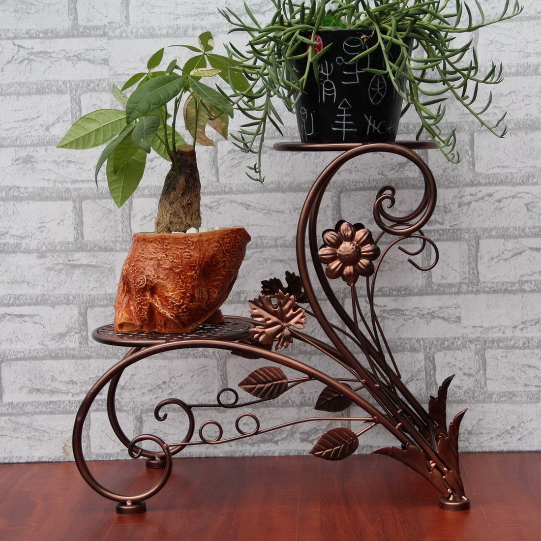 Bronze flower stand with forged leafs