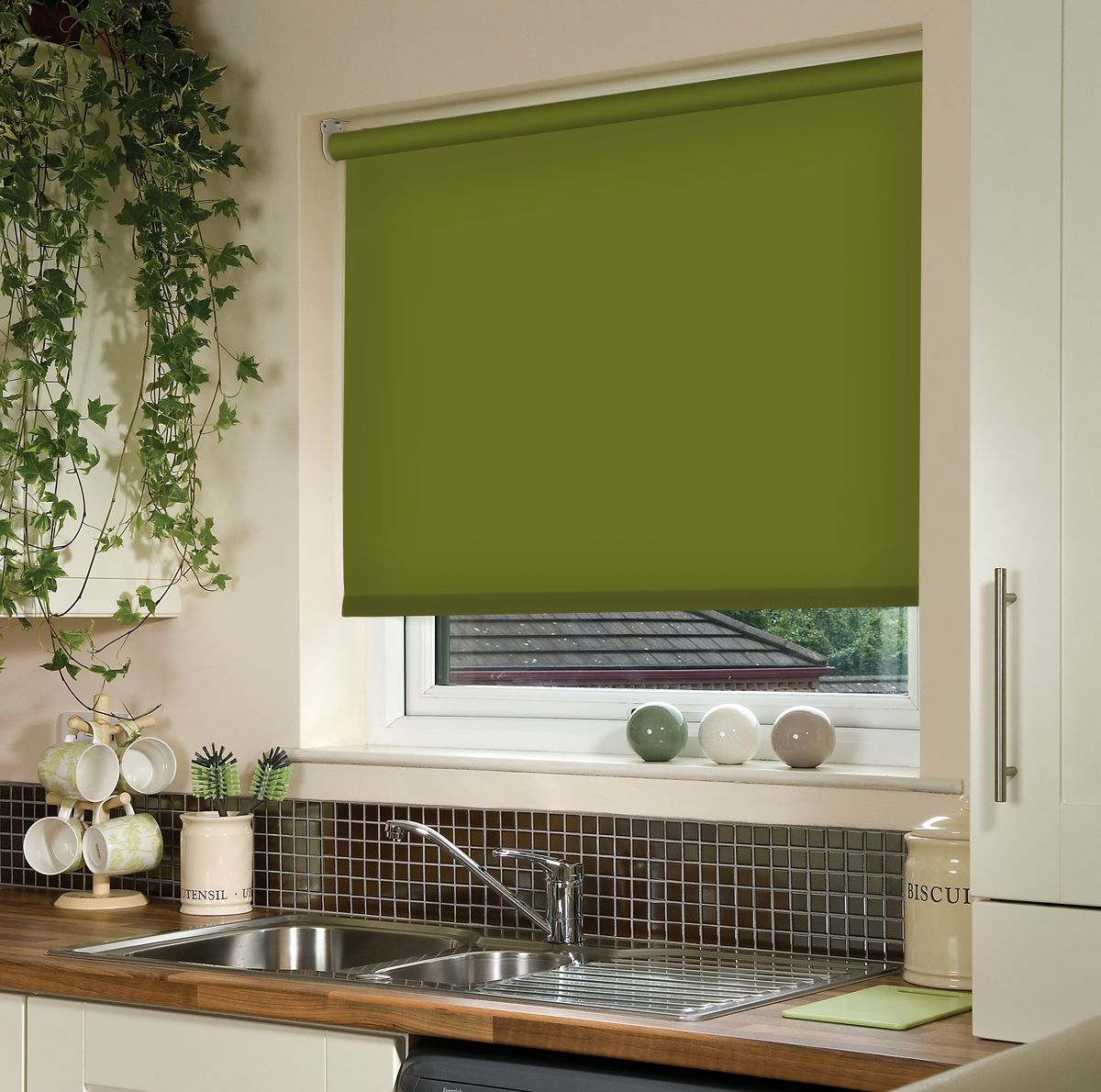 Roller Blinds: Practical and Good Looking Window Treatment. Wide thick green curtain for kitchen