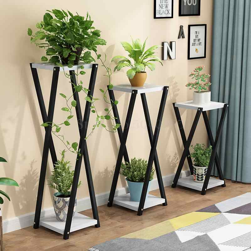 Black criss cross welded rods to create unique designed flower stands
