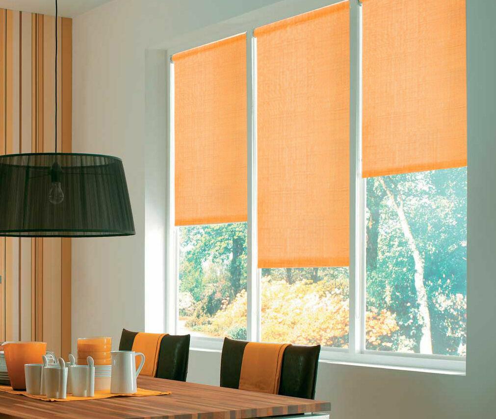 Bright orange roller blinds in light dining room