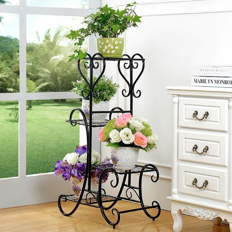 Black metal flower stand of forged semi-circles