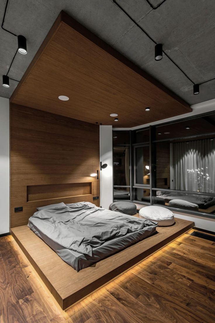 Unusual ceiling and floor rectangular wooden platforms to echo with each other in the bedroom