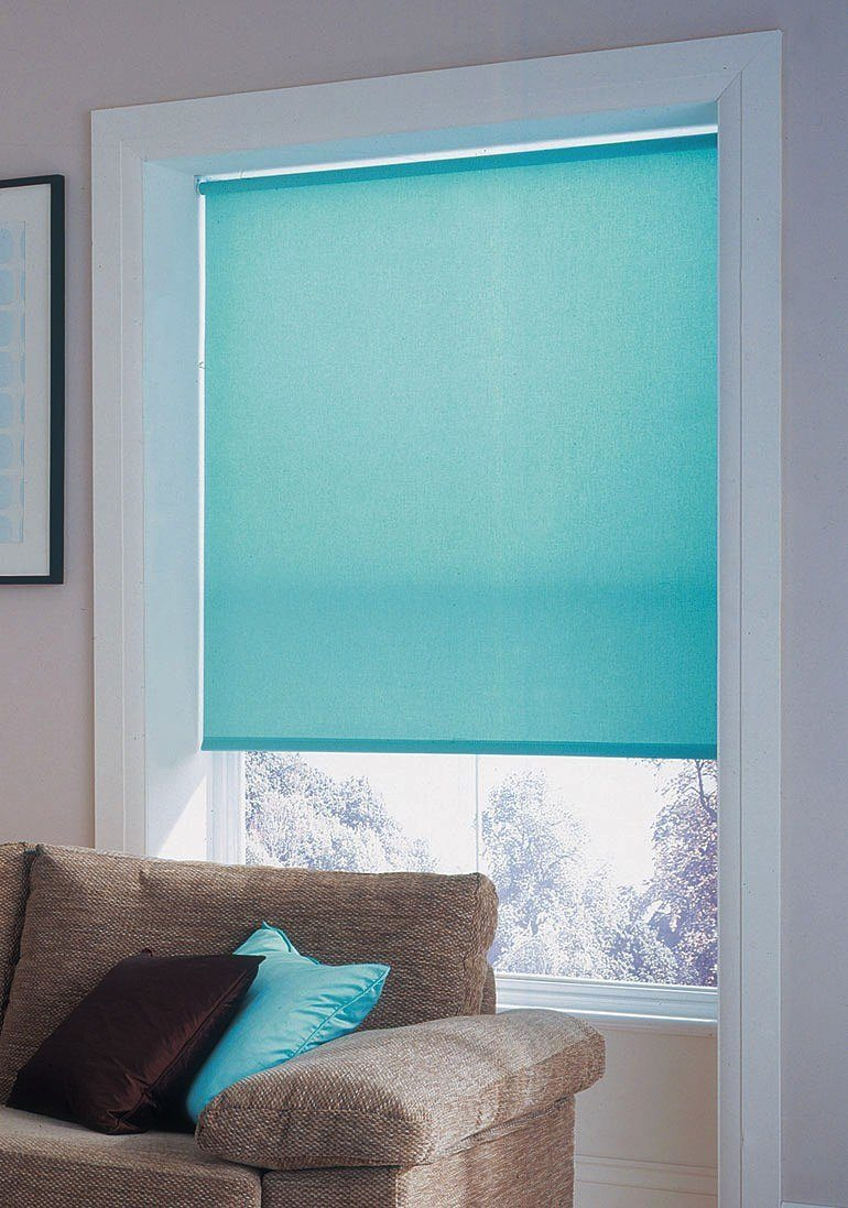 Aquamarine colored roller blinds as an accent for interior design