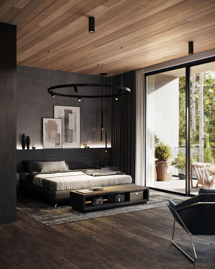 Black ring chandelier over the king size bed in black masculine bedroom interior with backlight of the shelf