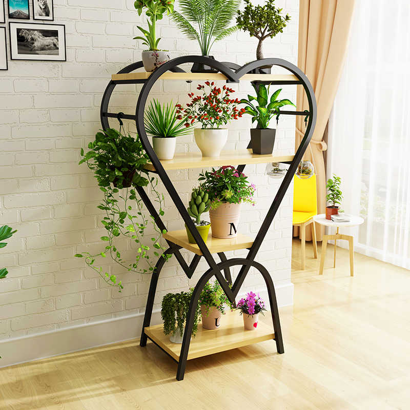 Gorgeous heart-looking flower stand made of black metal