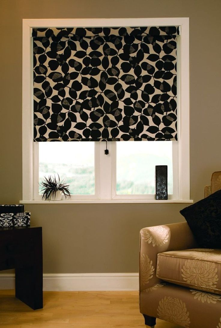Black dots on the roller blinds curtain to introduce some darkness of African designed room