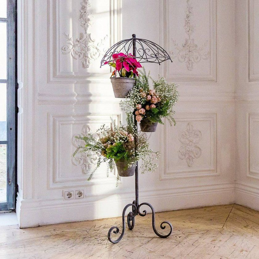 Exquisite flower stand with improvised umbrella at the top