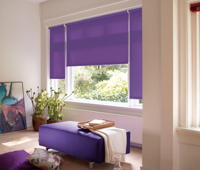Deep purple colored roller blinds and the ottoman