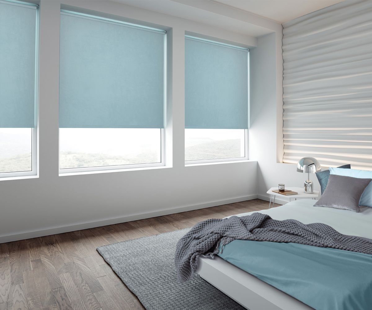 White colored walls and bluish large blinds