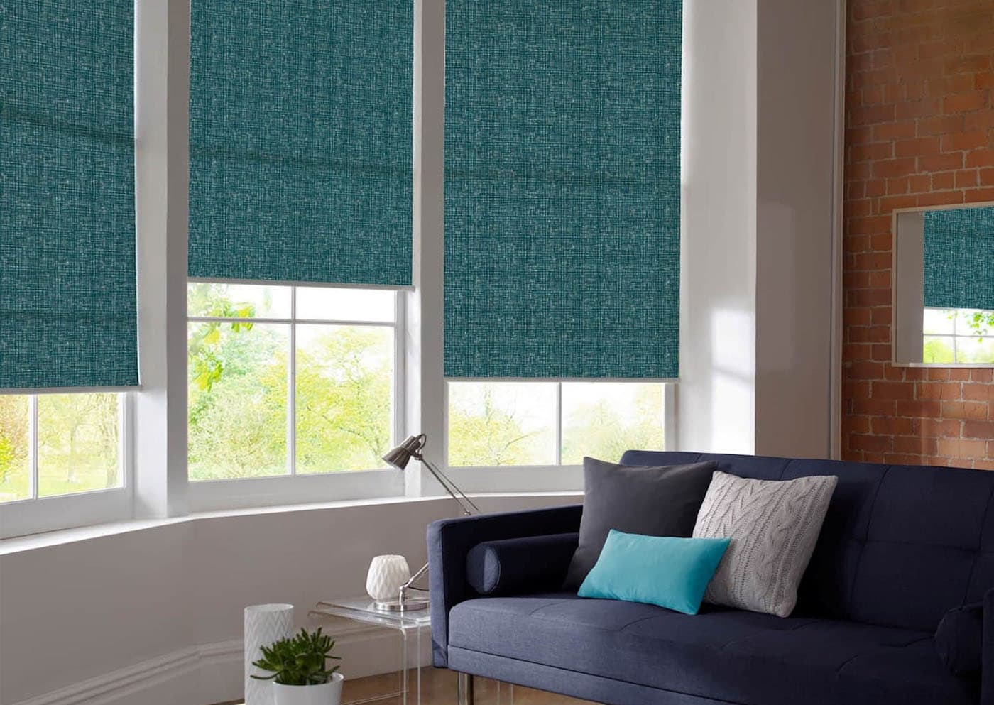 Dark emerald roller blinds with slight texture