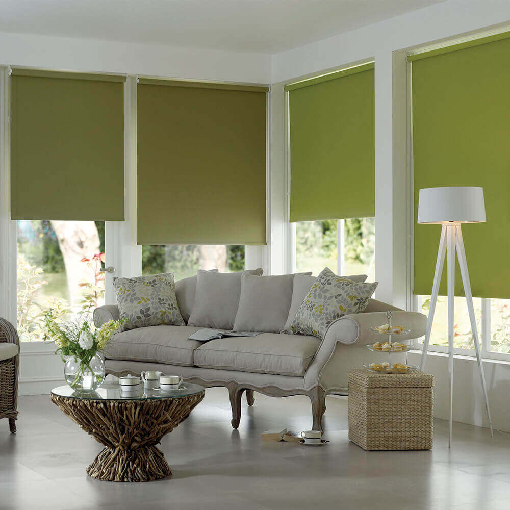 Many window by all the perimeter of large living room with rattan coffee table