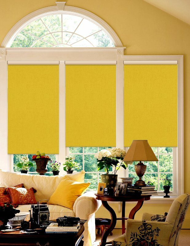 Bright yellow roller blinds on large sectional windows