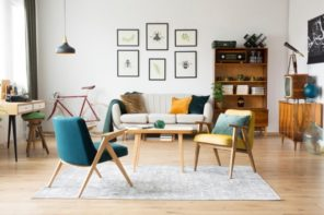 Casual living room with wooden lounge chairs and similar table and picture decorated wall