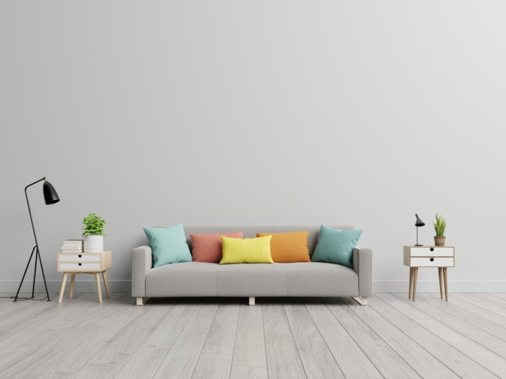 7 Simple Ways to Freshen Up Your Home This Spring. Gray living room with the colorful pillows on the sofa