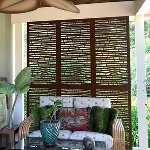 Twig woven partition between zones in casual styled studio