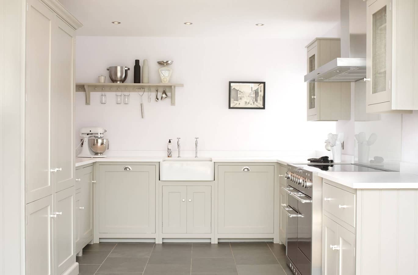 White and gray classic styled kitchen arranged with minimalist approach
