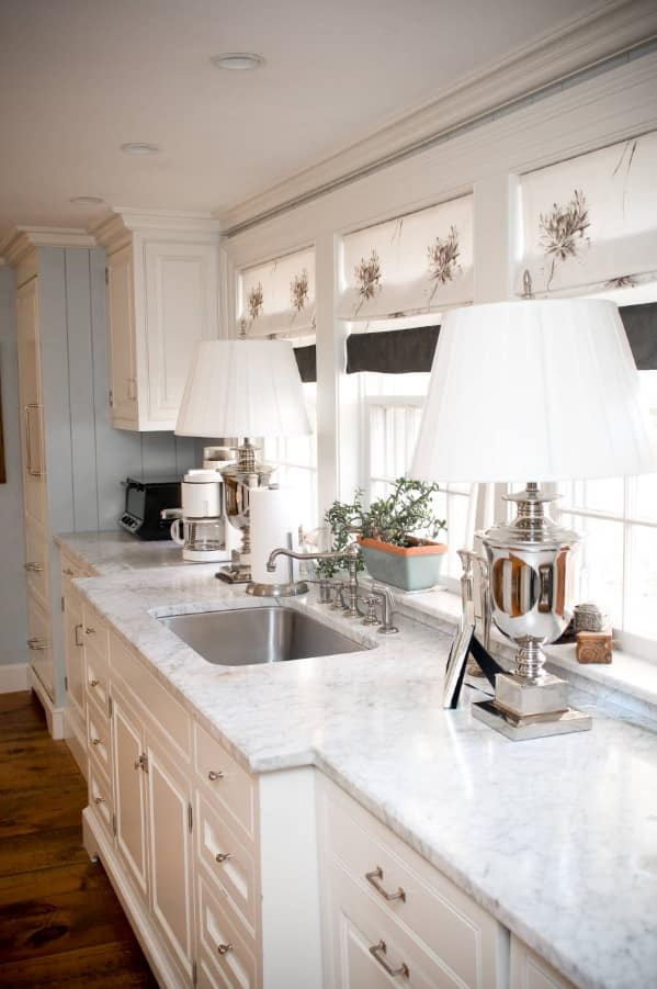 Provence styled kitchen with large marble countertop and mortise sink