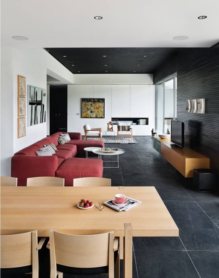 Best Tiles for Your Living Room. Dark large ceramic tiles for contrasting modern open space