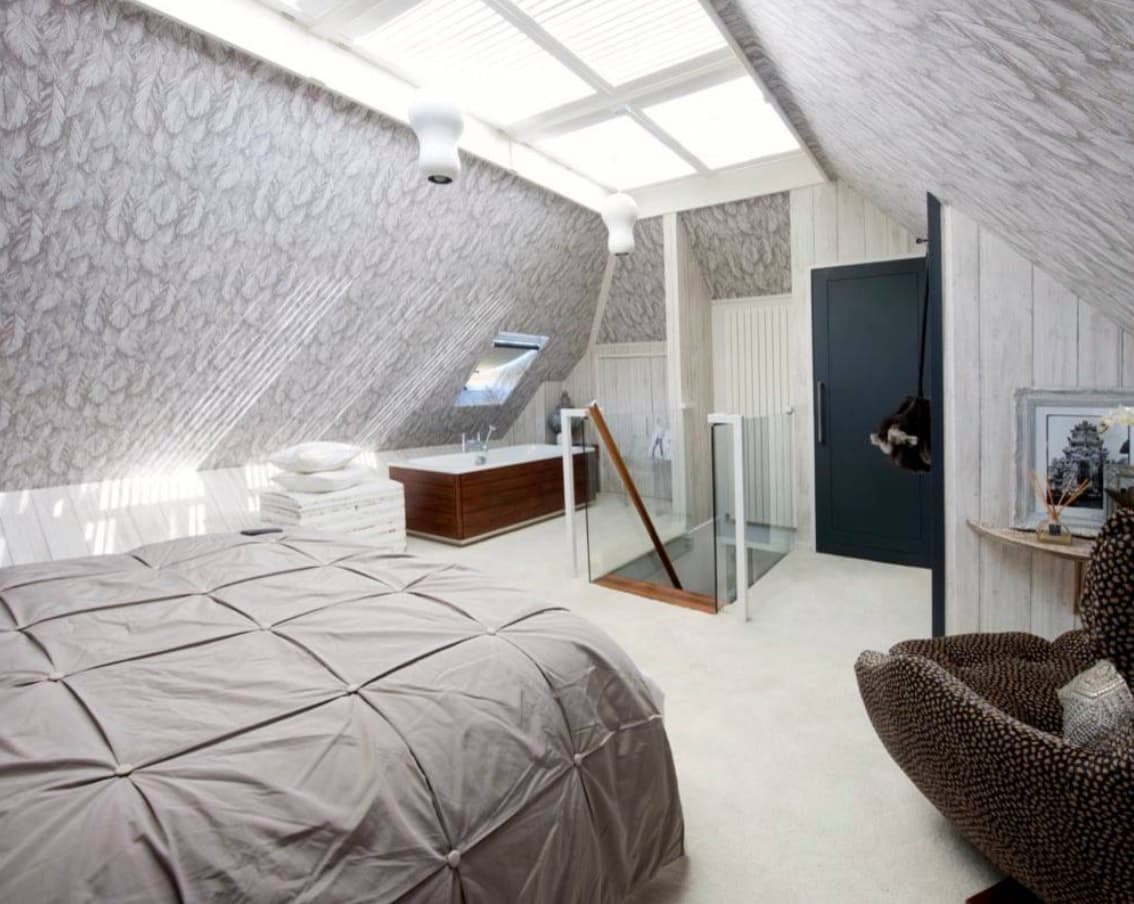 8 Best Loft Conversion Ideas for 2020. Great idea of additional loft room with bath and bed as well as the skylight